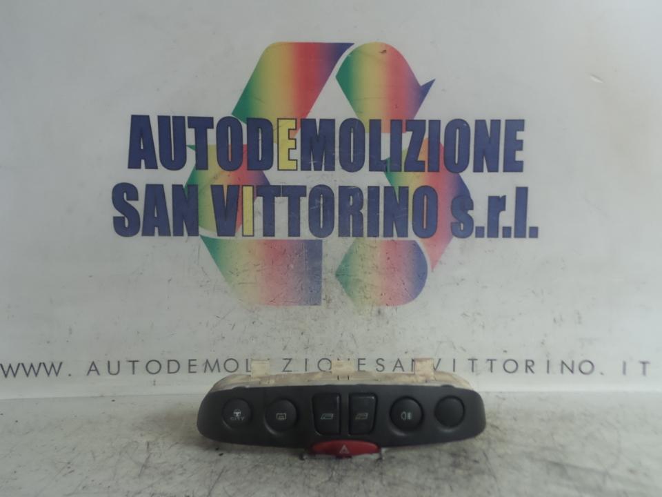 BLOCCO COMANDI MULTIFUNZIONI C/CRISTALLI ELET. FIAT PUNTO (2U) (07/03>01/07